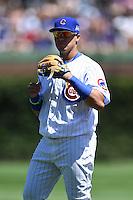 Chicago Cubs second baseman Javier Baez (9) warms up before a game against the Milwaukee Brewers on August 14, 2014 at Wrigley Field in Chicago, Illinois.  Milwaukee defeated Chicago 6-2.  (Mike Janes/Four Seam Images)