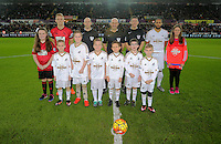 Children mascots, referee Roger East, Swansea captain Ashley Williams and Darren Fletcher captain for West Brom during the Barclays Premier League match between Swansea City and West Bromwich Albion played at the Liberty Stadium, Swansea on December 26 2015