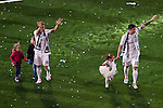 Real Madrid's players Luka Modric and James with his kids during the celebration of the victory of the Real Madrid Champions League at Santiago Bernabeu in Madrid. May 29. 2016. (ALTERPHOTOS/Borja B.Hojas)