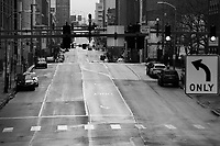 An empty Boulevard of the Allies in downtown during rush hour on Monday March 23, 2020 in Pittsburgh, Pennsylvania. (Photo by Jared Wickerham/Pittsburgh City Paper)