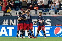 FOXBOROUGH, MA - AUGUST 18: Tommy McNamara #26 of New England Revolution celebrates his goal with teammates during a game between D.C. United and New England Revolution at Gillette Stadium on August 18, 2021 in Foxborough, Massachusetts.
