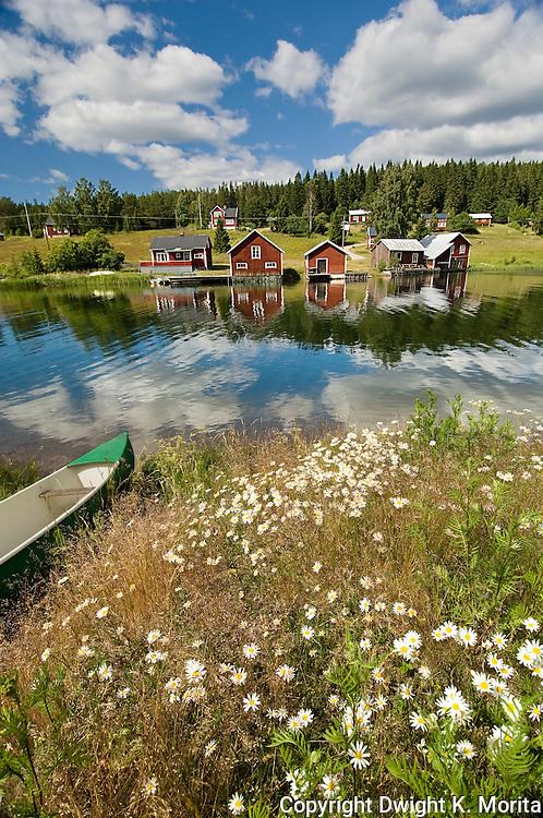 A canoe awaits a rider on a beautiful summer day on the waterway in Fallesvikshamn near Nordingra on the Baltic coast.