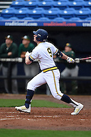 Michigan Wolverines infielder Travis Maezes (9) hits a home run during the first game of a doubleheader against the Siena Saints on February 27, 2015 at Tradition Field in St. Lucie, Florida.  Michigan defeated Siena 6-2.  (Mike Janes/Four Seam Images)