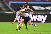 John McGinn of Aston Villa and Michail Antonio of West Ham United  during West Ham United vs Aston Villa, Premier League Football at The London Stadium on 30th November 2020