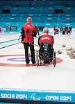Sochi, RUSSIA - Mar 7 2014 -  Joe Rea and Jim Armstrong of Canada's Wheelchair Curling Team trains before the Sochi 2014 Paralympic Winter Games in Sochi, Russia.  (Photo: Matthew Murnaghan/Canadian Paralympic Committee)