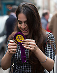 © Joel Goodman - 07973 332324 . 20/11/2014 . Kent , UK . ) . Rochester College student GURPREET BAINS ( 18 ) burns a UKIP rosette in front of the UKIP shop on High Street Rochester , in protest at UKIP policies . The Rochester and Strood by-election campaign following the defection of sitting MP Mark Reckless from Conservative to UKIP . Photo credit : Joel Goodman