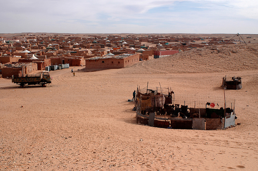 """A view of the """"February 27"""" wilaya is seen on December 12, 2003. Saharawi people have been living at the refugee camps of the Algerian desert named Hamada, or desert of the deserts, for more than 30 years now. Saharawi people have suffered the consecuences of European colonialism and the war against occupation by Moroccan forces. Polisario and Moroccan Army are in conflict since 1975 when Hassan II, Moroccan King in 1975, sent more than 250.000 civilians and soldiers to colonize the Western Sahara when Spain left the country. Since 1991 they are in a peace process without any outcome so far. (Ander Gillenea / Bostok Photo)"""