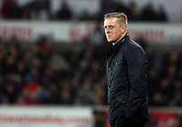 SWANSEA, WALES - MARCH 16: Swansea manager Garry Monk watches on during the last minutes of the Premier League match between Swansea City and Liverpool at the Liberty Stadium on March 16, 2015 in Swansea, Wales