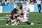 North Texas Mean Green defensive back Zed Evans (1) and UNLV Rebels wide receiver Taylor Spencer (21) in action during the Heart of Dallas Bowl game between the North Texas Mean Green and the UNLV Rebels at the Cotton Bowl Stadium in Dallas, Texas. UNT defeats UNLV 36 to 14.