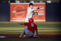 Tampa Yankees shortstop Kyle Holder (12) turns a double play as Chris Chinea (5) slides into second base during a game against the Palm Beach Cardinals on July 25, 2017 at George M. Steinbrenner Field in Tampa, Florida.  Tampa defeated Palm beach 7-6.  (Mike Janes/Four Seam Images)