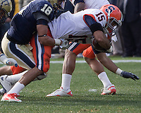 Pitt defensive back Jarred Holley (18) tackles Syracuse wide receiver Alec Lemon (15). The Pittsburgh Panthers beat the Syracuse Orange 33-20 at Heinz Field in Pittsburgh, Pennsylvania on December 3, 2011
