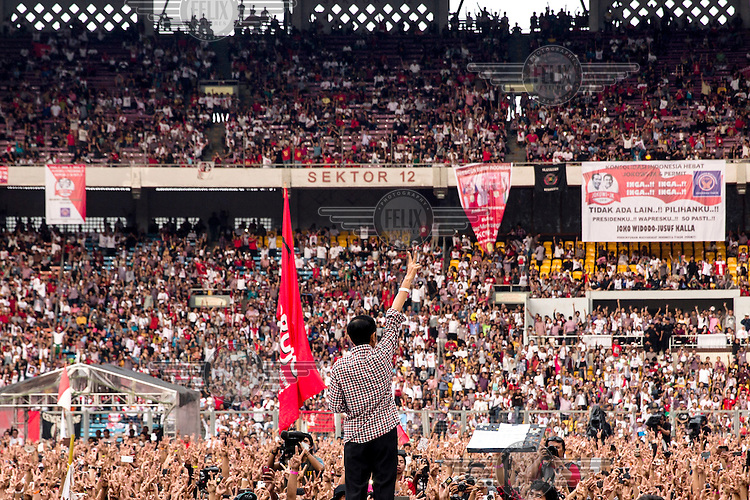 Indonesian presidential candidate, Joko Widodo waves to thousands of his supporters on the last day of the election campaign period in Jakarta.