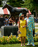 SARATOGA SPRINGS, NY - AUGUST 25: A couple poses for a photo on Travers Stakes Day at Saratoga Race Course on August 25, 2018 in Saratoga Springs, New York. (Photo by Carson Dennis/Eclipse Sportswire/Getty Images)