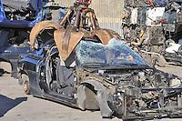 - car demolition at Milan outskirts<br /> <br /> - demolizione di autoveicoli alla periferia di milano