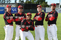 Batavia Muckdogs Scott Carcaise (13), Aaron Blanton (11), Miles Williams (26), Ryan Aper (3) and Kevin Grove (12) pose for a photo before a game against the Jamestown Jammers on July 8, 2014 at Dwyer Stadium in Batavia, New York.  The game was postponed due to wet grounds.  (Mike Janes/Four Seam Images)