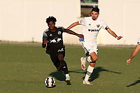 RICHMOND, VA - SEPTEMBER 30: Bo Cummins #83 of New York Red Bulls II is chased by Manny Perez #2 of North Carolina FC during a game between North Carolina FC and New York Red Bulls II at City Stadium on September 30, 2020 in Richmond, Virginia.