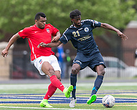 Malden, Massachusetts - June 4, 2017: In a National Premier Soccer League (NPSL) match, Boston City FC (red/white) defeated Hartford City FC (blue), 3-1, at Brother Gilbert Stadium.