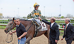 DONE TALKING and jockey Sheldon Russell are congratulated by the connections of Skeedattle Stable & Trainer Hamilton A. Smith after winning the GIII TVG Illinois Derby at Hawthorne Race Course in Cicero/Stickney, IL.