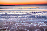 Sunrise on frozen sea foam at Revere Beach, Revere, Massachusetts, USA