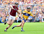Joseph Cooney of Galway in action against David Reidy of Clare during their All-Ireland semi-final replay at Semple Stadium,Thurles. Photograph by John Kelly.