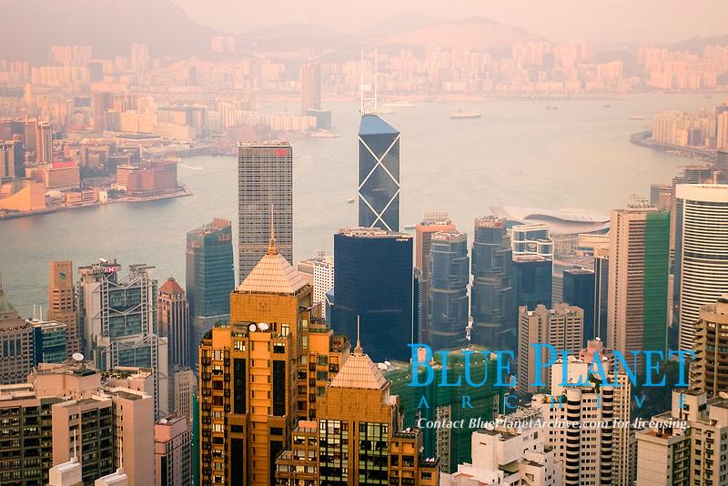 Hong Kong's modern skyline overlooking Victoria harbour and Kowloon peninsula at dusk, Hong Kong, China