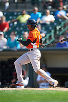 Norfolk Tides outfielder Julio Borbon (5) at bat during a game against the Rochester Red Wings on May 3, 2015 at Frontier Field in Rochester, New York.  Rochester defeated Norfolk 7-3.  (Mike Janes/Four Seam Images)
