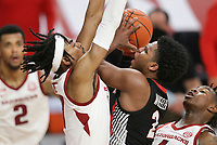 Arkansas guard Jalen Tate (11) blocks Georgia Sahvir Wheeler (2), Saturday, January 9, 2021 during the second half of a basketball game at Bud Walton Arena in Fayetteville. Check out nwaonline.com/210110Daily/ for today's photo gallery. <br /> (NWA Democrat-Gazette/Charlie Kaijo)