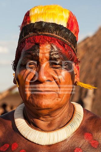 Xingu Indigenous Park, Mato Grosso, Brazil. Aldeia Matipu. Cacique Tafukuma Kalapalo. Toucan feather headress and shell necklace.