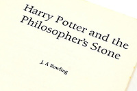"""BNPS.co.uk (01202) 558833<br /> Pic: Ewbank's/BNPS<br /> <br /> """"J.A Rowling""""<br /> <br /> A rare uncorrected proof of Harry Potter and the Philosopher's Stone by 'J.A. Rowling' written on the title page has sold at auction for more than £23,000.<br /> <br /> The 24 year old erroneous copy, one of 200 printed, is covered in its original white and yellow wrappers and is already generating muggle excitement."""