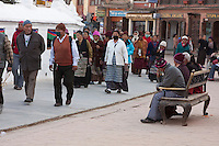 Bodhnath, Nepal.  Pilgrims and visitors circumambulate the stupa (on their right) in a clockwise direction, especially in late afternoon hours.