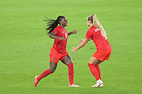 YOKOHAMA, JAPAN - AUGUST 6: Deanne Rose #6 of Canada celebrates with Adriana Leon #9 during a game between Canada and Sweden at International Stadium Yokohama on August 6, 2021 in Yokohama, Japan.