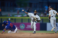 Charleston RiverDogs shortstop Johan Lopez (32) forces out Harvin Mendoza (38) of the Kannapolis Cannon Ballers at second base as Brett Wisely (5) looks on at Atrium Health Ballpark on July 1, 2021 in Kannapolis, North Carolina. (Brian Westerholt/Four Seam Images)