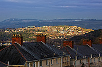 The Bonymaen area is lit by the setting sun as seen from Townhill, Swansea, UK. 20 March 2018