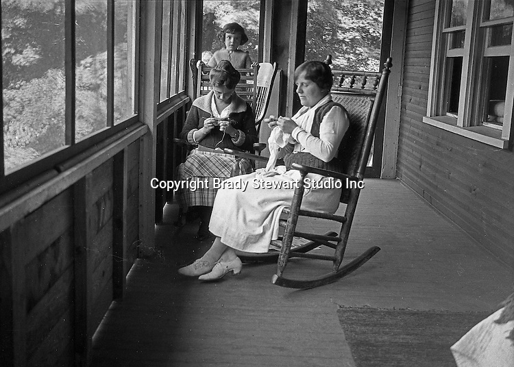 North East PA: Aunt Helen and Sarah Stewart knitting on the porch during a rainy day at the lake.  Little Helen watching mom and Aunt Helen.  This was the Stewart family's first Lake Erie vacation after Brady Stewart served his country during World War 1.  Stewart's family rented a cabin on Lake Erie near North East.