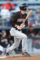 Delmarva Shorebirds Kipp Schutz #23 swings at a pitch during  a game against  the  Asheville Tourists at McCormick Field in Asheville,  North Carolina;  May 6, 2011. The Shorebirds won the game 6-5.  Photo By Tony Farlow/Four Seam Images
