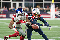 FOXBORO, MA - OCTOBER 10: New England Patriots Cornerback Stephon Gilmore (24) competes with New York Giants Wide Receiver Darius Slayton (86) to block a catch during a game between New York Giants and New England Patriots at Gillettes on October 10, 2019 in Foxboro, Massachusetts.