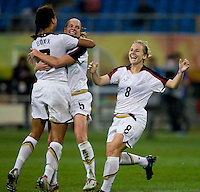 Shannon Boxx, Lindsay Tarpley, Amy Rodriguez. The USWNT defeated New Zealand, 4-0, during the 2008 Beijing Olympics in Shenyang, China.  With the win, the USWNT won group G and advanced to the semifinals.