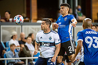 SAN JOSE, CA - AUGUST 13: Brian White #24 of the Vancouver Whitecaps and Luciano Abecasis #2 of the San Jose Earthquakes compete for the ball during a game between San Jose Earthquakes and Vancouver Whitecaps at PayPal Park on August 13, 2021 in San Jose, California.
