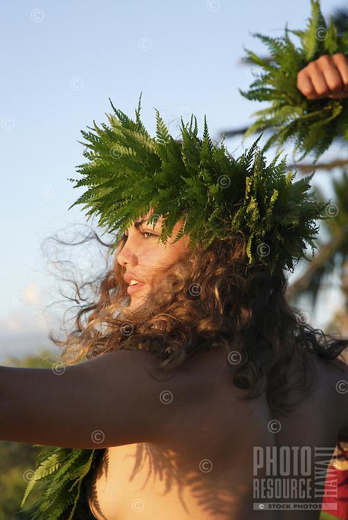 Female (wahine) hula dancer with palapalai fern head lei, headshot.
