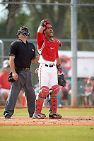 Ohio State Buckeyes catcher Jalen Washington (2) and umpire keep their on a popup during a game against the Illinois State Redbirds on March 5, 2016 at North Charlotte Regional Park in Port Charlotte, Florida.  Illinois State defeated Ohio State 5-4.  (Mike Janes/Four Seam Images)