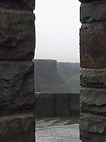 A glimpse of the Cliffs of Moher through a castle doorway on the west coast of Ireland.