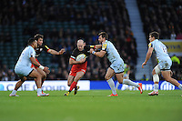 Charlie Hodgson of Saracens is tackled by Wynand Olivier of Worcester Warriors during the Premiership Rugby match between Saracens and Worcester Warriors - 28/11/2015 - Twickenham Stadium, London<br /> Mandatory Credit: Rob Munro/Stewart Communications
