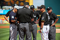 Pittsburgh Pirates Tom Prince (14) during the lineup exchange with Joe Girardi (left) and umpires Bill Welke (home), Chad Fairchild, Jeremie Rehak, and Tom Hallion before a Grapefruit League Spring Training game against the New York Yankees on March 6, 2017 at LECOM Park in Bradenton, Florida.  Pittsburgh defeated New York 13-1.  (Mike Janes/Four Seam Images)