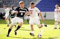 Bryan Minogue (5) of the Providence Friars and Nick DeLeon (14) of the Louisville Cardinals battle for the ball. The Louisville Cardinals defeated the Providence Friars 3-2 in penalty kicks after playing to a 1-1 tie during the finals of the Big East Men's Soccer Championship at Red Bull Arena in Harrison, NJ, on November 14, 2010.