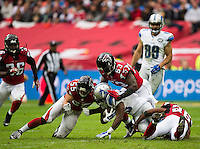 26.10.2014.  London, England.  NFL International Series. Atlanta Falcons versus Detroit Lions. Lions' RB Joique Bell [35] is stopped by the Atlanta defence.