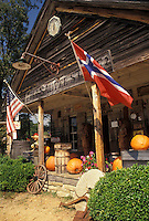 AJ4114, country store, North Georgia, Appalachian Mountains, The Confederate and United States flag fly from the front porch of the Old Sautee Store in Nacochee in the state of Georgia.