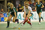 Berlin, Germany, February 01: Antonia Zengerle #23 of HTC Uhlenhorst Muehlheim vies for the ball with Elisa Graeve #26 of Duesseldorfer HC during the 1. Bundesliga Damen Hallensaison 2014/15 final hockey match between Duesseldorfer HC (white) and HTC Uhlenhorst Muehlheim (green) on February 1, 2015 at the Final Four tournament at Max-Schmeling-Halle in Berlin, Germany. Final score 4-1 (1-0). (Photo by Dirk Markgraf / www.265-images.com) *** Local caption ***