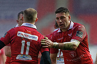 Kieron Fonotia of the Scarlets (R) congratulates try scorer Ioan Nicholas (L) during the Guinness Pro14 Round 17 match between the Scarlets and Munster Rugby at the Parc Y Scarlets Stadium, Llanelli, Wales, UK. Saturday 02 March 2019