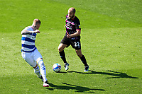 24th April 2021; The Kiyan Prince Foundation Stadium, London, England; English Football League Championship Football, Queen Park Rangers versus Norwich; Teemu Pukki of Norwich City takes on Lee Wallace of Queens Park Rangers