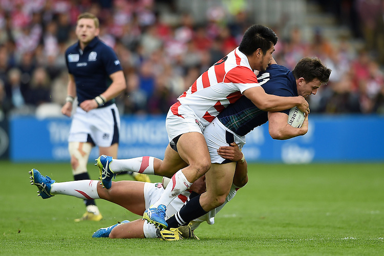 Matt Scott of Scotland  is tackled to ground by Shota Horie of Japan. Rugby World Cup Pool B match between Scotland and Japan on September 23, 2015 at Kingsholm Stadium in Gloucester, England. Photo by: Patrick Khachfe / Stewart Communications